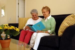 two senior women sitting on the sofa